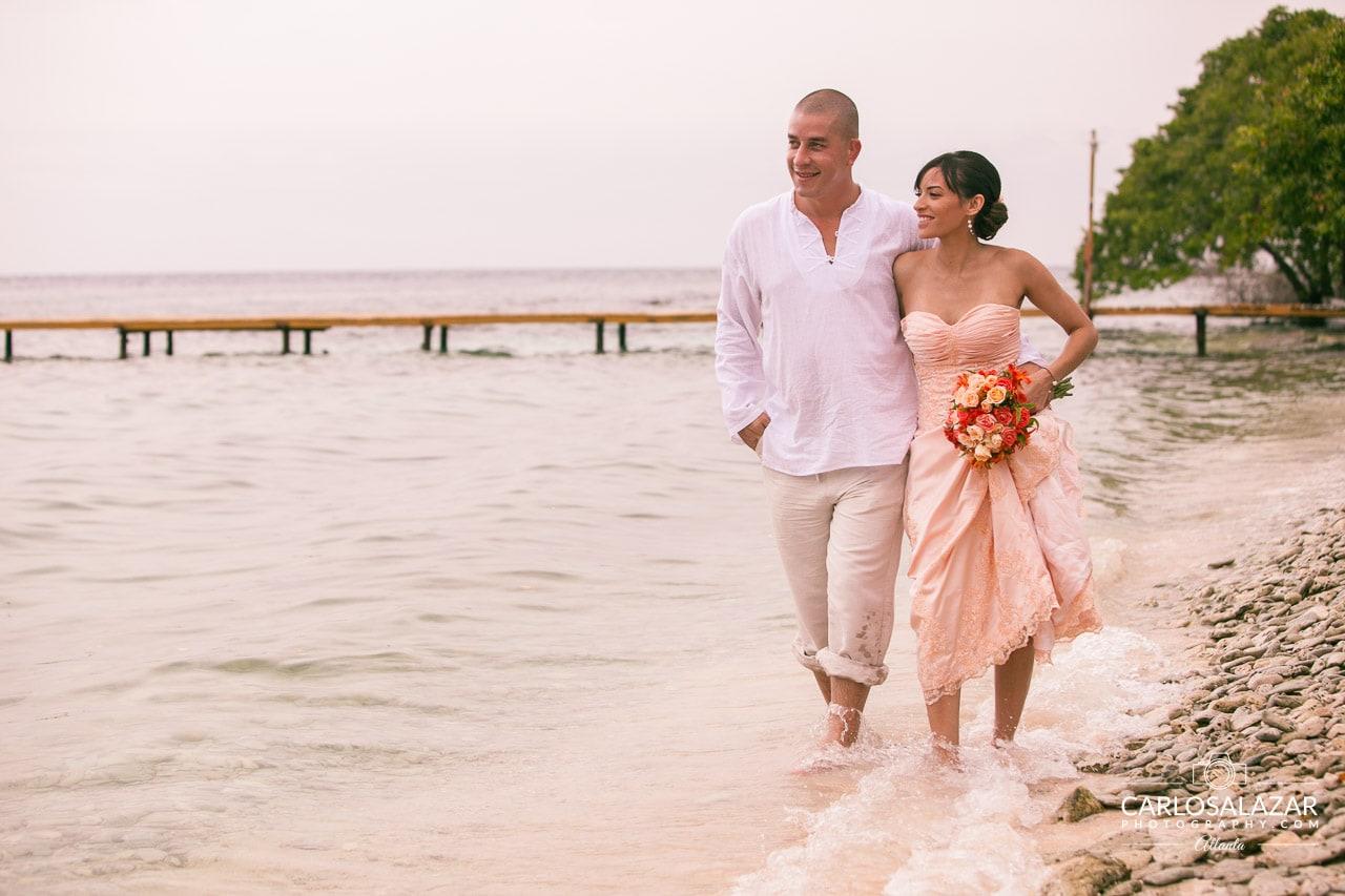 Wedding couple walking at the beach
